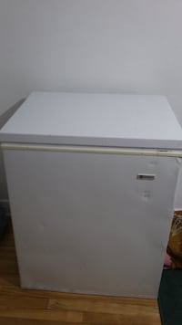 white and beige wooden cabinet