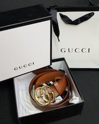 gold Gucci buckle with brown leather belt Eureka