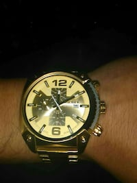 round gold Diesel chronograph watch]