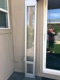 Removable doggie door for sliding glass door