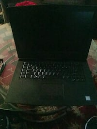 black laptop computer with AC adapter Costa Mesa, 92626