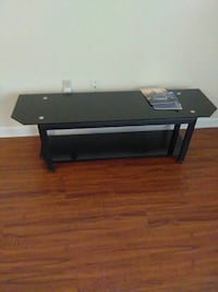 black and gray TV stand