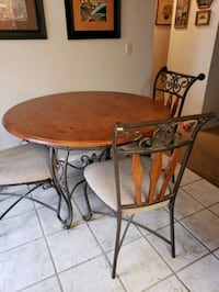 Wood top table with metal base, 4 chairs and baker Henderson, 89014