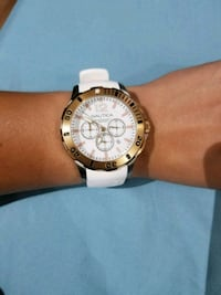 round gold-colored chronograph watch with white strap San Diego