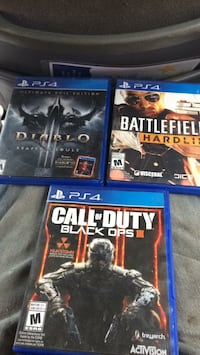Three assorted ps4 game cases Windsor, N8X