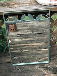 Metal mirror with leaf accents
