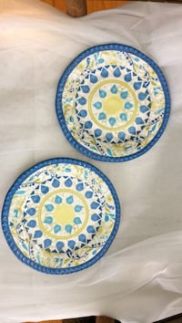 two round yellow, white, and, blue ceramic plates