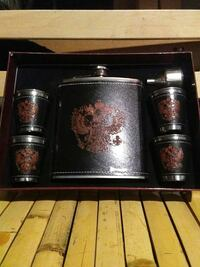 brown, black, and stainless steel liquor flask with four cups in box Edmonton, T5E 2V7