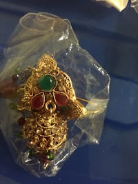 gold-colored with green and red gemstones insect pendant