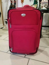 red and black luggage bag 370 mi