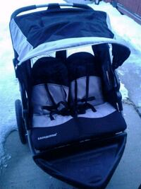 baby's black and gray twin stroller