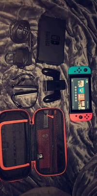 Nintendo switch everything included come with a few games Abbotsford, V2S 3M2