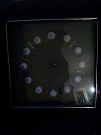 square white and black analog wall clock