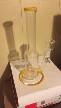 clear and yellow glass bong