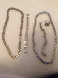 four silver and gold-colored chain necklaces
