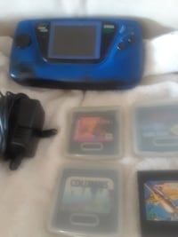 blue and black Sega console with charger