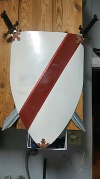 white and red shield and sword decor Lathrop
