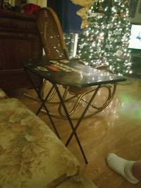 clear glass-top table with black steel base Welland, L3B 5V8