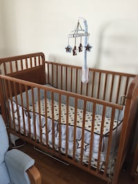 Wooden crib, bedding, mobile and mattress