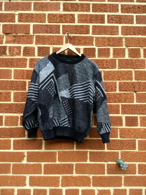 black and gray geometric sweater 0