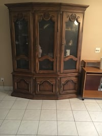 brown wooden framed glass display cabinet Delray Beach, 33484