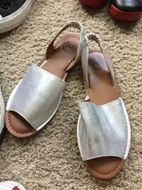 pair of gray leather open-toe sandals