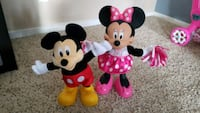 two Mickey Mouse and Minnie Mouse figurines Minneapolis, 55435