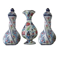 three blue, green, and red ceramic vases London