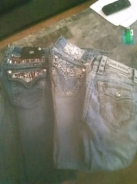three blue Rock Revival and Miss Me denim jeans Clarksville, 72830
