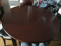 Wooden round dinning room table with 4 chairs