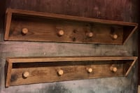 Rustic wood shelves with cork knobs