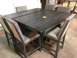 Dining table and chairs with removable leaf