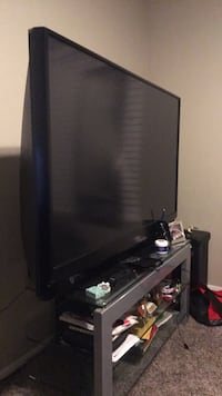 black flat screen TV with remote Chandler, 85286