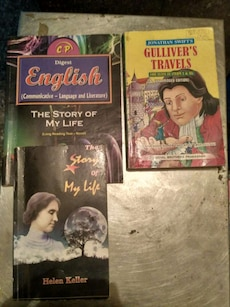 three assorted learning books