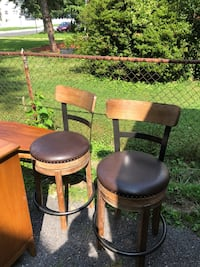two brown wooden framed black leather padded bar stools Silver Spring, 20906