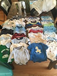 baby's assorted clothes