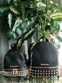 two black Michael Kors leather backpacks 35 km