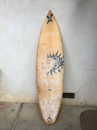 brown and black surf board