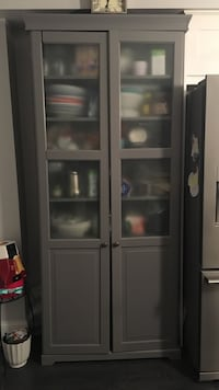 Grey wood framed glass pantry or storage