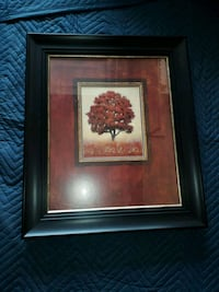 brown wooden framed painting of red flower