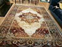 brown and white floral area rug Coquitlam, V3J 1W9