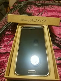 black Samsung Galaxy S5 with box