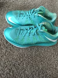 pair of teal-and-white Nike basketball shoes Saint Peters, 63376