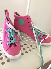 pair of pink-and-green sneakers 3744 km