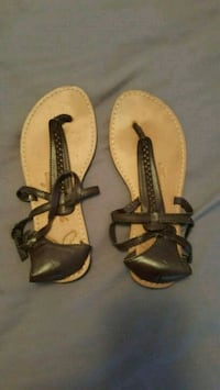 pair of brown leather thong sandals Clinton