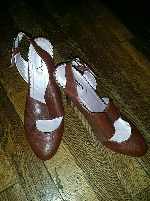 pair of brown-and-silver pump heels 0