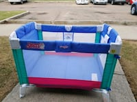 blue, green, and pink  travel fold up playpen Edmonton, T5X 4P4