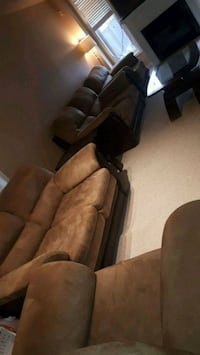 brown leather 2 love seat 2 chair  497 km