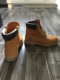 pair of brown-and-black Timberland work boots