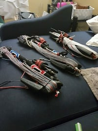three black-and-red corded power tools